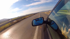 Sport car driving, mirror reflection. hood side reference. mounted camera Stock Footage