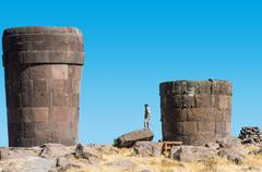 tourist silustani tombs in the peruvian andes at puno peru - stock photo