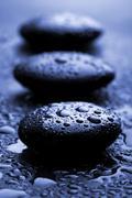 Shiny zen stones with water drops Stock Photos
