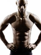 Young african muscular build man topless silhouette Stock Photos