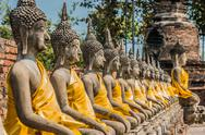 Stock Photo of aligned buddha statues wat yai chaimongkol ayutthaya bangkok thailand