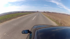 speeding a highway, view from roof of the car toward mirror and road line - stock footage