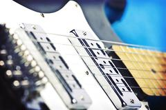 Close up on black and white electric guitar Stock Photos