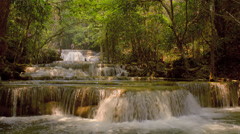 Cascading Waterfalls in a River in Kanchanaburi Thailand Stock Footage