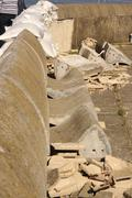 Wall damage with sandbags - stock photo