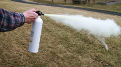 0916 Man Using a Fire Extinguisher, Slow Motion - stock footage
