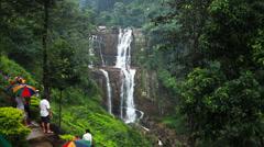 Tourists near a waterfall Stock Footage
