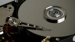 Hard Disk Drive Spinning with Arm Reading Blue Spindle Stock Footage