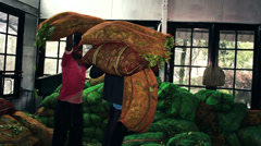 workers loaded bags with tea leaves - stock footage