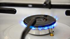 Natural gas inflammation in stove burner, close up side view loop Stock Footage