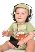 One year old boy with headphones and MP3 player Stock Photos