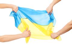 people fighting for ukrainian flag - stock photo