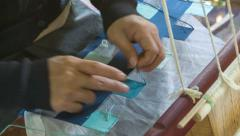 Weaving by hands on the old loom Stock Footage