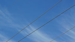 Blue cloudy sky with wires Stock Footage
