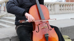 A street musician playing the cello. Stock Footage