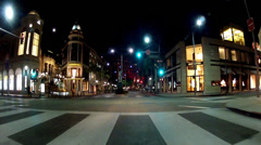 Night Wide Shot Driving On Rodeo Drive In Beverly Hills California Stock Footage