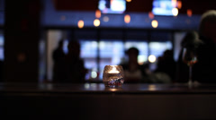 Bar Atmosphere | flickering candle in a moody bar - stock footage