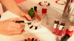 Nail technician painting fake nails Stock Footage