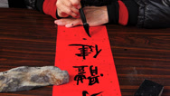 Stock Video Footage of Chinese New Year Calligraphy Fai Chun writing Traditional Chinese culture