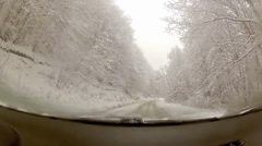 Driver pov view of winter snow drive around curve on snowy country road Stock Footage