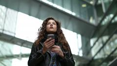 Attractive young woman using her mobile device for directions - stock footage
