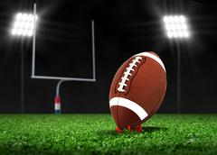 Football ball on grass under spotlights Stock Illustration