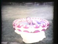 little girl plays in blow up pool, mid 1960's - stock footage