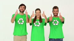 Team of environmental activists smiling at camera showing thumbs up - stock footage