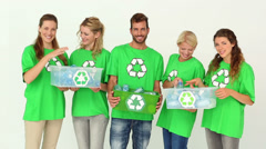 Team of environmental activists smiling at camera holding boxes - stock footage