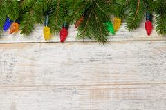 Stock Photo of christmas background with lights on branches