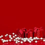 red christmas background with gift boxes - stock photo
