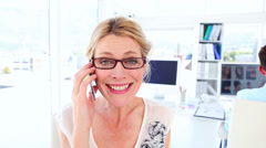 Excited businesswoman getting good news over the phone - stock footage