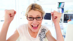 Excited businesswoman cheering at camera Stock Footage