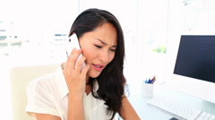 Businesswoman getting bad news on the phone Stock Footage