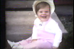 little girl takes first steps outside 1960's - stock footage