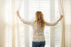 Woman looking out window Stock Photos