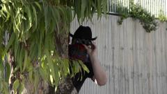 Cowboy ambushes with binoculars Stock Footage