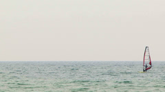 Man adores serfing in the Black Sea. - stock footage