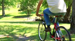 Happy couple going for a bike ride in the park Stock Footage