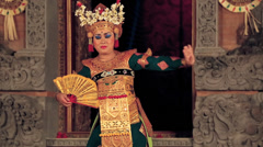 Balinese dancer in traditional costume performing in the Barong dance Stock Footage
