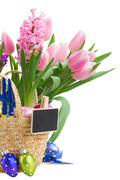 hyacinth and tulip flowers with easter eggs - stock photo