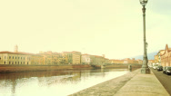 Stock Video Footage of Girl Walking Along Arno River