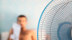 Young Man and Fan, Summer theme Stock Footage