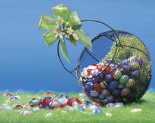 Easter colored eggs in the basket Stock Photos