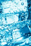 ice cubes in water bubbles - stock photo