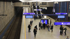 People at the platform of the main, central train station in Warsaw, Poland Stock Footage