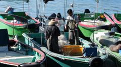 Chinese Fisherman sorting net Cheung Chau island shelter Hong Kong China Asia Stock Footage