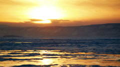 Sunset on the winter lake Stock Footage