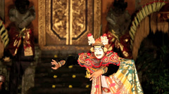 Balinese dancer on stage in the Legong dance Stock Footage