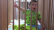 Stock Video Footage of Boy in a crib